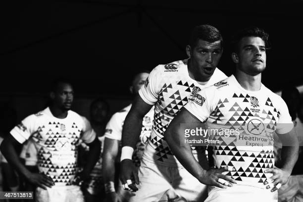 James Rodwell talks to Tom Mitchell of England before their Pool A match between England and South Africa at Westpac Stadium on February 7 2014 in...