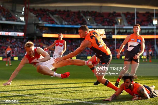 James Rose of the Swans is tackled by Heath Shaw of the Giants during the round 20 AFL match between the Greater Western Sydney Giants and the Sydney...