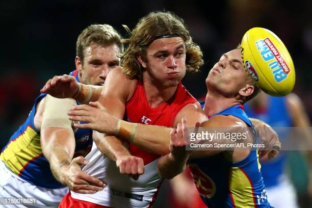 James Rowbottom of the Swans is tackled during the round 15 AFL match between the Sydney Swans and the Gold Coast Suns at Sydney Cricket Ground on...