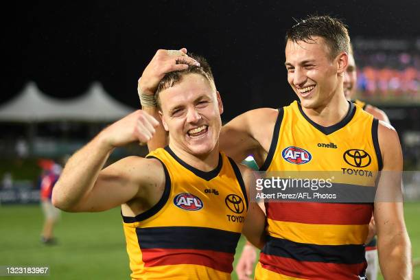 James Rowe of the Crows celebrates after his team's victory during the round 13 AFL match between the St Kilda Saints and the Adelaide Crows at...