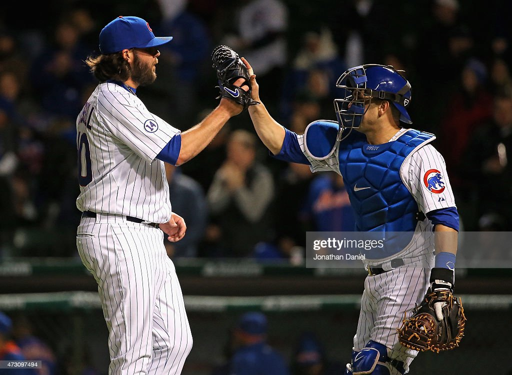 James Russell #40 (L) and Miguel Montero #47 of the Chicago Cubs celebrate a win over the New York Mets at Wrigley Field on May 12, 2015 in Chicago, Illinois. The Cubs defeated the Mets 6-1.