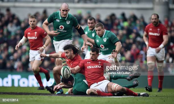 James Ryan of Ireland is tackled by Aaron Shingler and Josh Navidi of Wales during the Six Nations Championship rugby match between Ireland and Wales...