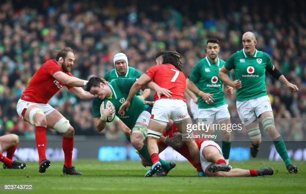 James Ryan of Ireland is tackled by Alun Wyn Jones and Josh Navidi of Wales during the NatWest Six Nations match between Ireland and Wales at Aviva...