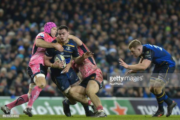 James Ryan of Leinster team in action challenged by Tom Waldrom and Sam Simmonds of Exeter Chiefs during the European Rugby Champions Cup rugby match...