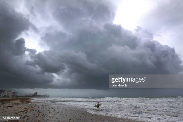 James Sampero surfs in the churning ocean as Hurricane Irma approaches on September 9 2017 in Miami Beach Florida Florida is in the path of the...