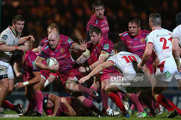 James Scaysbrook of Exeter Chiefs powers his way through the Scarlets defence to score the decisive try during the Heineken Cup Pool Five match...