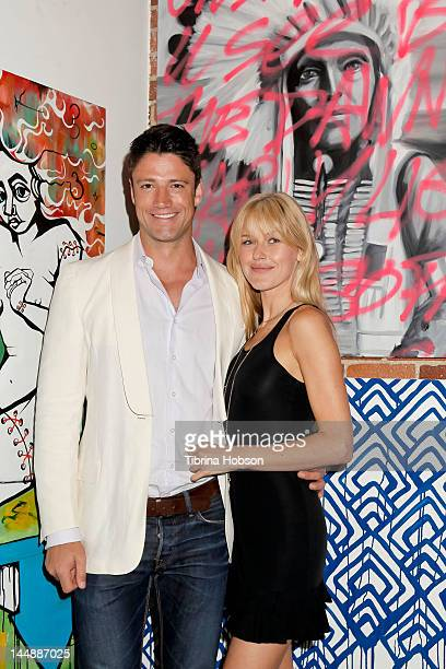 James Scott and Kaitlin Robinson attend 'The Usual Suspects' art installation 1 year anniversary at LAB ART on May 19 2012 in Los Angeles California