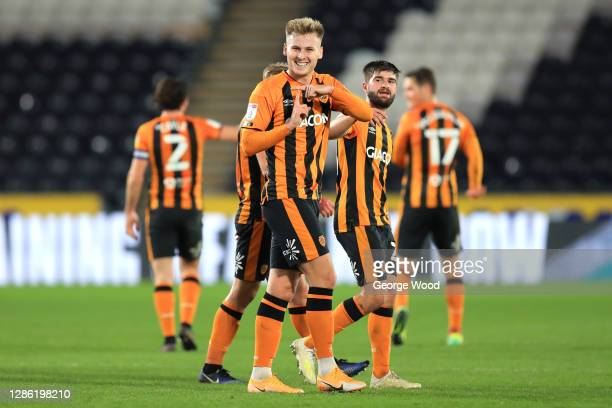 James Scott of Hull City celebrates after scoring his sides third goal during the EFL Trophy match between Hull City and Grimsby Town at KCOM Stadium...