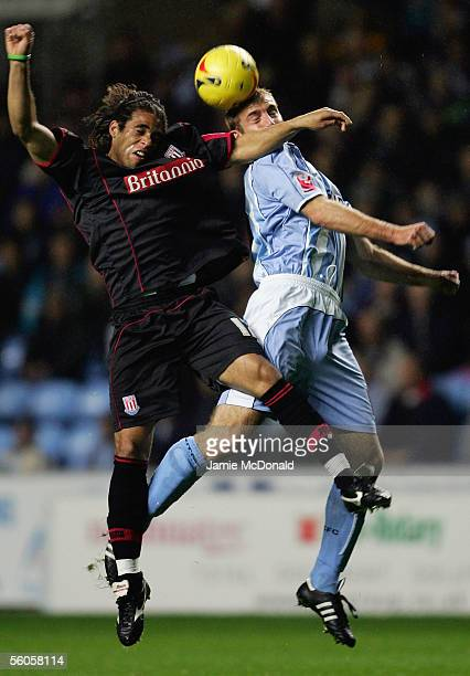 James Scowcroft of Coventry battles with Darel Russell of Stoke during the Coca Cola Championship match between Coventry City and Stoke City at the...