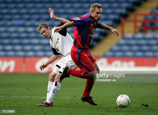James Scowcroft of Crystal Palace gets away from Chris Sedgwick of Preston during the FA Cup sponsored by EON 4th Round match between Crystal Palace...