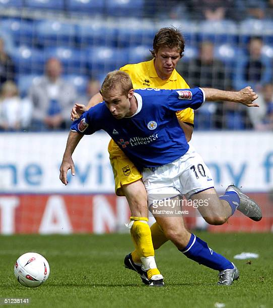 James Scowcroft of Leicester looks to beat Dean Hammond of Brighton during the CocaCola Championship match between Leicester City and Brighton and...
