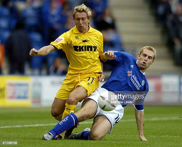 James Scowcroft of Leicester tackles Darren Currie of Brighton during the CocaCola Championship match between Leicester City and Brighton and Hove...
