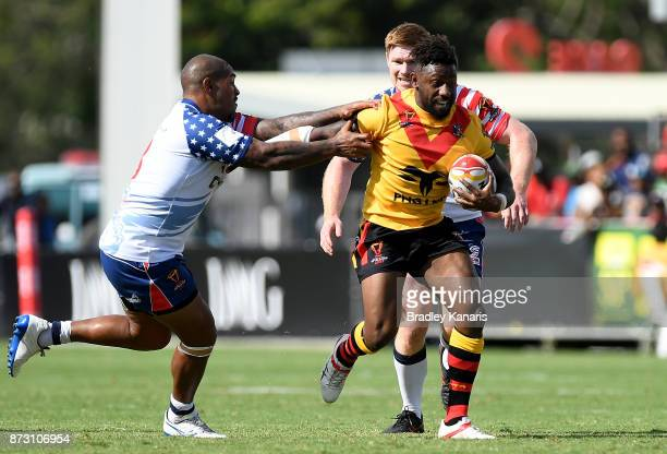 James Segeyaro of Papua New Guinea breaks away from the defence during the 2017 Rugby League World Cup match between Papua New Guinea and the United...