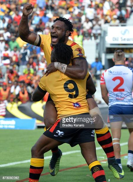 James Segeyaro of Papua New Guinea celebrates with team mate Garry Lo during the 2017 Rugby League World Cup match between Papua New Guinea and the...