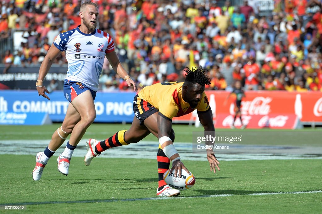 James Segeyaro of Papua New Guinea scores a try during the 2017 Rugby League World Cup match between Papua New Guinea and the United States on November 12, 2017 in Port Moresby, Papua New Guinea.