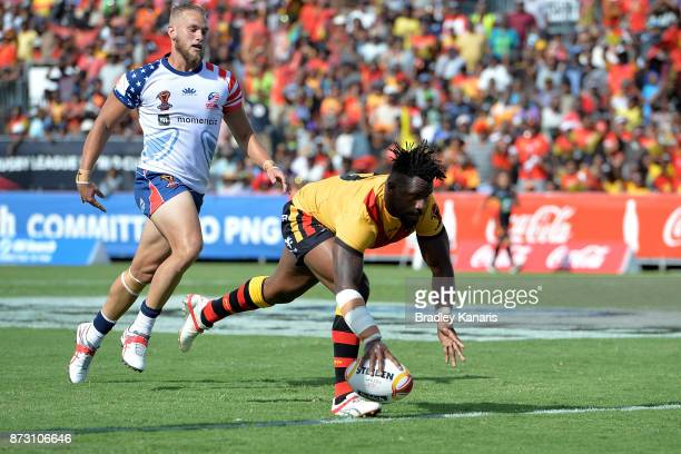 James Segeyaro of Papua New Guinea scores a try during the 2017 Rugby League World Cup match between Papua New Guinea and the United States on...