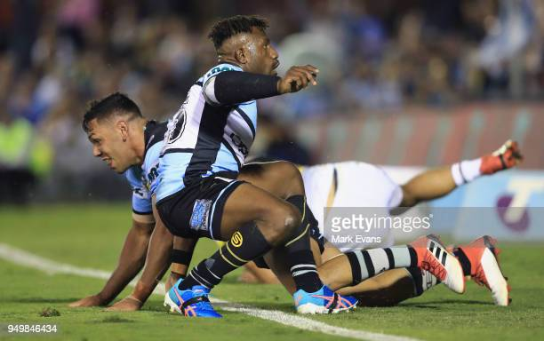 James Segeyaro of the Sharks celebrates a try scored by Jesse Ramien during the round seven NRL match between the Cronulla Sharks and the Penrith...