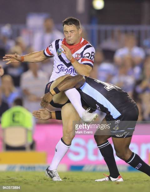 James Segeyaro of the Sharks is injured as he tackles Cooper Cronk of the Roosters during the round five NRL match between the Cronulla Sharks and...