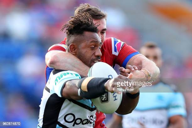 James Segeyaro of the Sharks is tackled by Connor Watson of the Knights during the round 12 NRL match between the Newcastle Knights and the Cronulla...