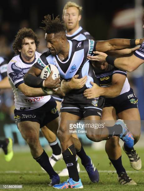James Segeyaro of the Sharks is tackled during the round 23 NRL match between the Cronulla Sharks and the North Queensland Cowboys at Southern Cross...