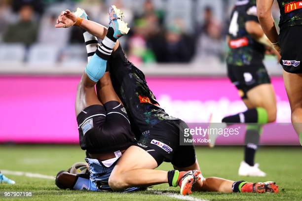 James Segeyaro of the Sharks is tackled Jack Wighton of the Raiders during the round 10 NRL match between the Canberra Raiders and the Cronulla...