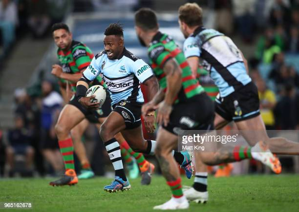 James Segeyaro of the Sharks makes a break during the round 13 NRL match between the South Sydney Rabbitohs and the Cronulla Sharks at ANZ Stadium on...