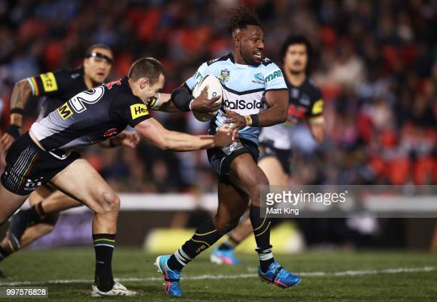 James Segeyaro of the Sharks makes a break during the round 18 NRL match between the Panthers and the Sharks at Panthers Stadium on July 13 2018 in...