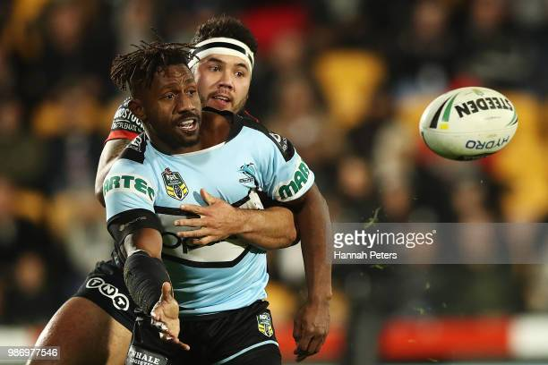 James Segeyaro of the Sharks offloads the ball during the round 16 NRL match between the New Zealand Warriors and the Cronulla Sharks at Mt Smart...