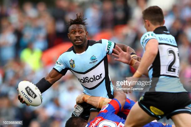 James Segeyaro of the Sharks offloads the ball during the round 24 NRL match between the Cronulla Sharks and the Newcastle Knights at Southern Cross...