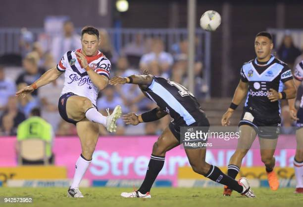 James Segeyaro of the Sharks tackles Cooper Cronk of the Roosters during the round five NRL match between the Cronulla Sharks and the Sydney Roosters...