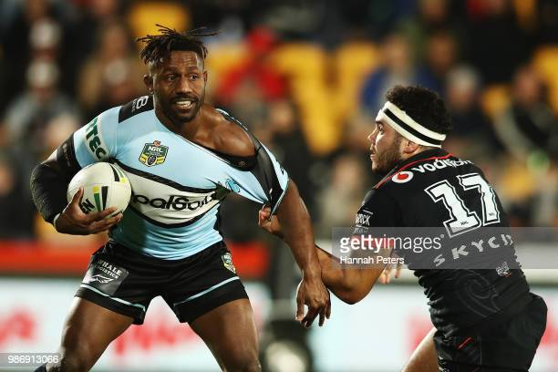 James Segeyaro of the Sharks ties to get past Jazz Tevaga of the Warriors during the round 16 NRL match between the New Zealand Warriors and the...