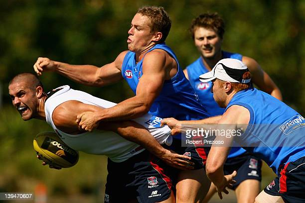 James Sellar is tackled during a Melbourne Demons AFL training session at Gosch's Paddock on February 22 2012 in Melbourne Australia