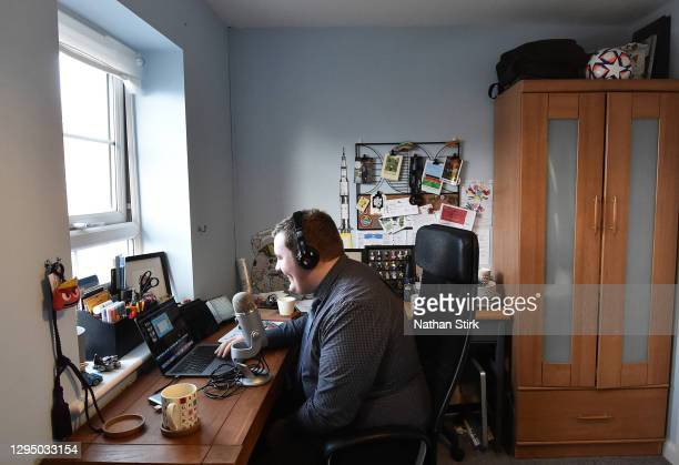 James Shaw, an employee of Twinkl, is recording online teaching materials at his home on January 07, 2021 in Stoke on Trent, England. Twinkl...
