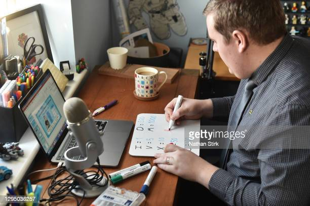 James Shaw, an employee of Twinkl, prepares online teaching materials at his home on January 07, 2021 in Stoke on Trent, England. Twinkl Educational...