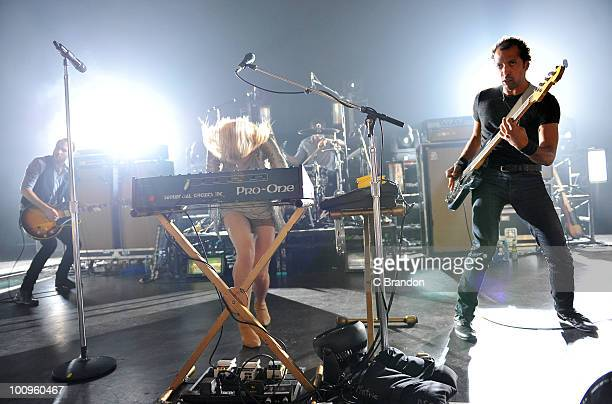 James Shaw Emily Haines and Josh Winstead of Metric perform on stage at Shepherds Bush Empire on May 24 2010 in London England