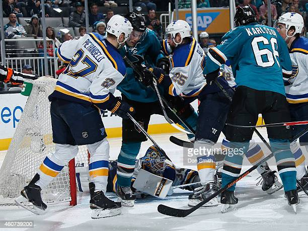 James Sheppard and Melker Karlsson of the San Jose Sharks crash the net against Alex Pietrangelo Jake Allen and Chris Butler of the St Louis Blues...