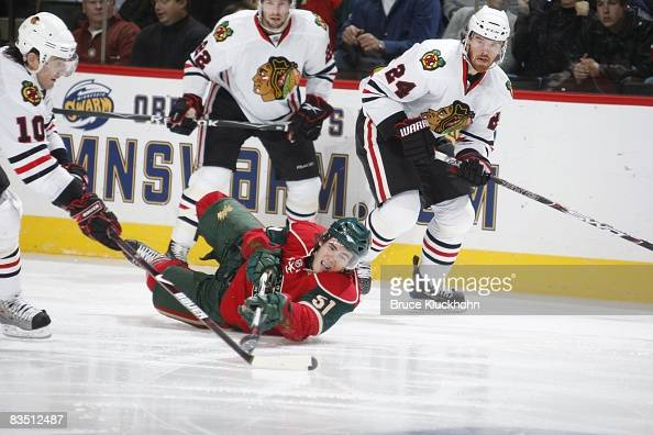 James Sheppard of the Minnesota Wild falls to the ice