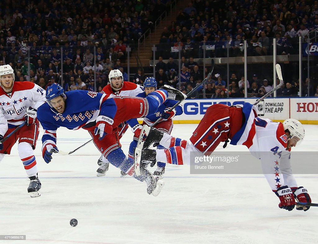 James Sheppard #45 of the New York Rangers is hit by Brooks Orpik #44 of the Washington Capitals during the second period in Game Two of the Eastern Conference Semifinals during the 2015 NHL Stanley Cup Playoffs at Madison Square Garden on May 2, 2015 in New York City.