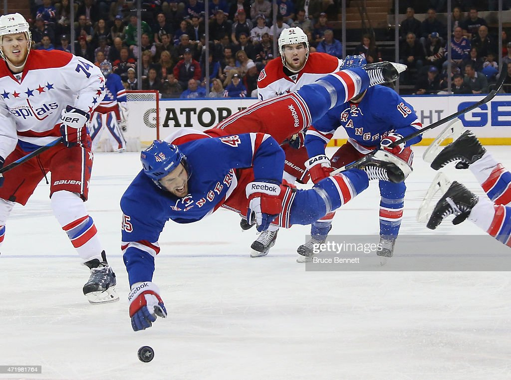 James Sheppard #45 of the New York Rangers is hit by Brooks Orpik #44 of the Washington Capitals during the second period in Game Two of the Eastern Conference Semifinals during the 2015 NHL Stanley Cup Playoffs at Madison Square Garden on May 2, 2015 in New York City. The Rangers defeated the Capitals 3-2.