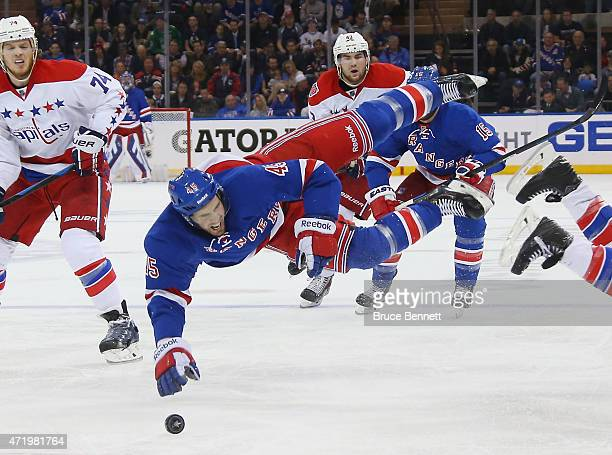 James Sheppard of the New York Rangers is hit by Brooks Orpik of the Washington Capitals during the second period in Game Two of the Eastern...
