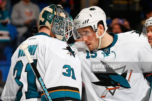 James Sheppard of the San Jose Sharks congratulates his teammate Antti Niemi after defeating the New York Islanders at Nassau Veterans Memorial...