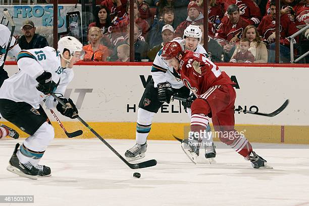 James Sheppard of the San Jose Sharks skates with the puck as Brandon McMillan of the Arizona Coyotes and Marc-Edouard Vlasic of the Sharks battle...