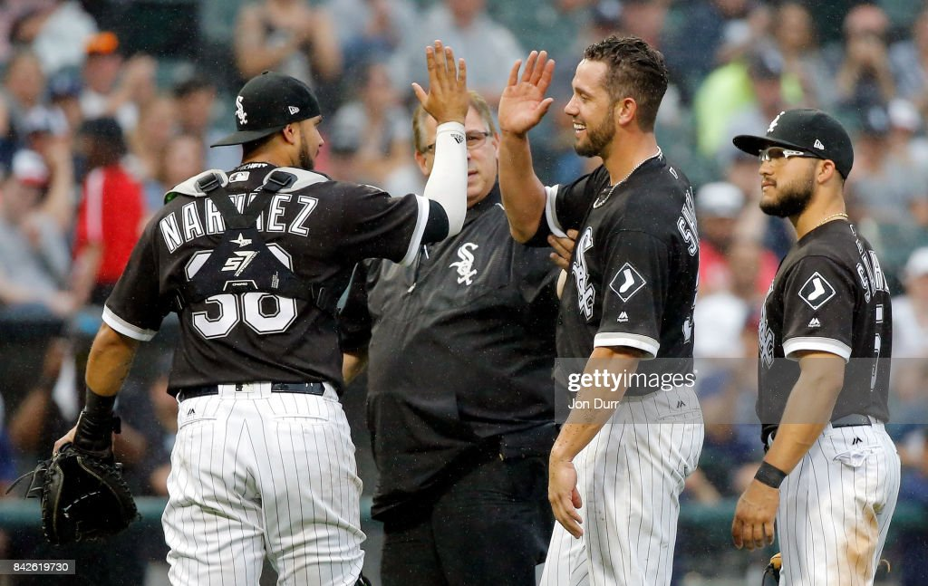James Shields #33 of the Chicago White Sox high fives Omar Narvaez #38 (L) as he leaves the game after being hit in the right leg by a line drive hit by Francisco Mejia #33 of the Cleveland Indians (not pictured) during the seventh inning at Guaranteed Rate Field on September 4, 2017 in Chicago, Illinois.
