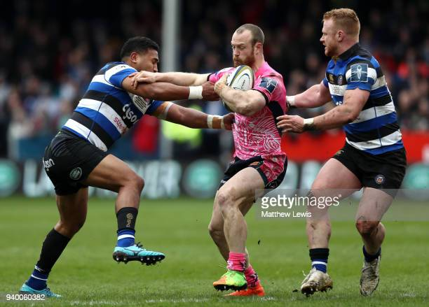 James Short of Exeter Chiefs holds of Will Hurrell and Cooper Vuna of Bath during the AngloWelsh Cup Final between Bath Rugby and Exeter Chiefs at...
