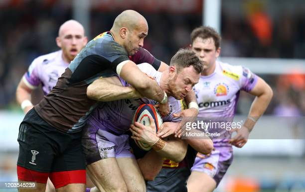 James Short of Exeter Chiefs is tackled by Aaron Morris of Harlequins during the semi-final of the Premiership Rugby Cup between Exeter Chiefs and...