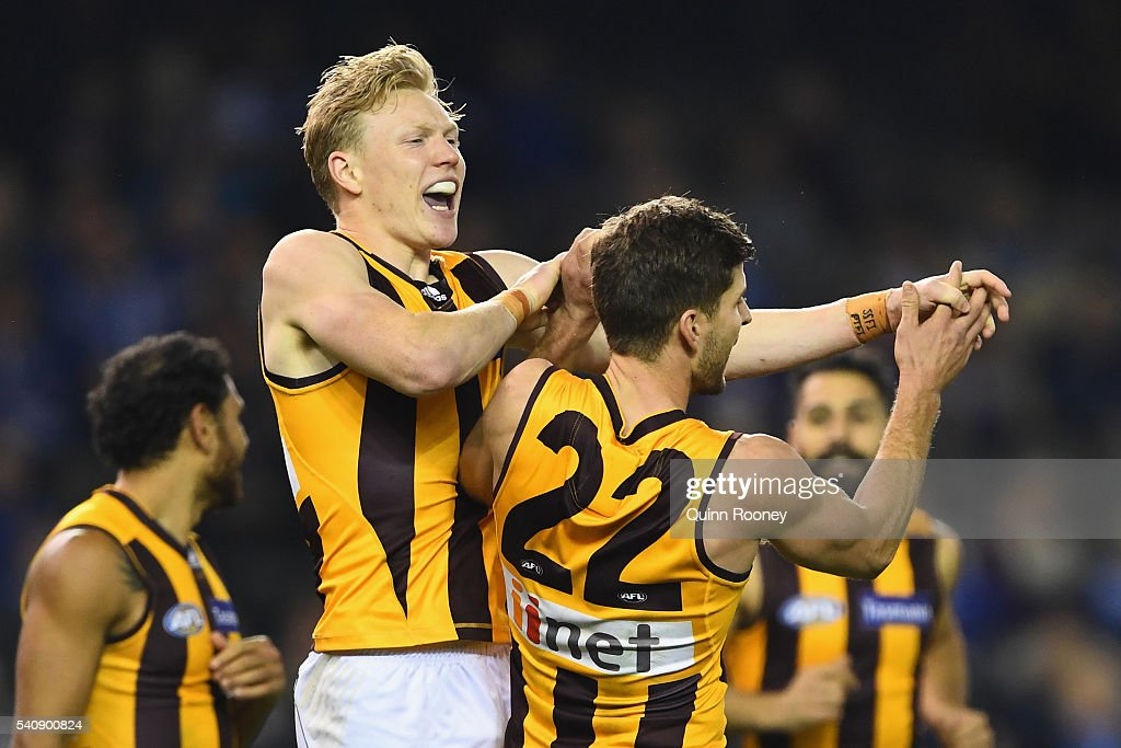 James Sicily of the Hawks is congratulated by Luke Breust after kicking a goal during the round 13 AFL match between the North Melbourne Kangaroos and the Hawthorn Hawks at Etihad Stadium on June 17, 2016 in Melbourne, Australia.