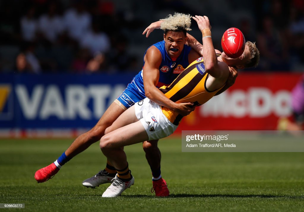 James Sicily of the Hawks is taken high by Jason Johannisen of the Bulldogs during the AFL 2018 JLT Community Series match between the Western Bulldogs and the Hawthorn Hawks at Mars Stadium on March 3, 2018 in Ballarat, Australia.