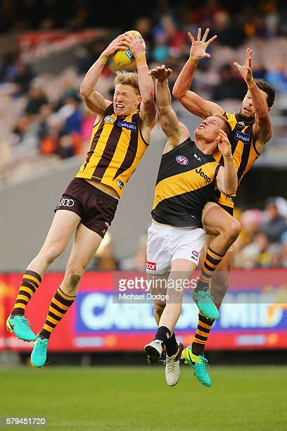 James Sicily of the Hawks marks the ball against Nick Vlastuin of the Tigers during the round 18 AFL match between the Hawthorn Hawks and the...