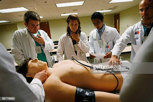 James Sikora , Kay Schmid, and Allen Sanchez all third year medical students at The Gordon Center for Research In Medical Education, University of...