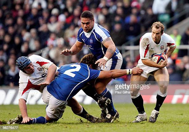 James SimpsonDaniel of England has his shorts held by Mahonori Schwalger of Samoa during the Investec Challenge match between England and Samoa at...